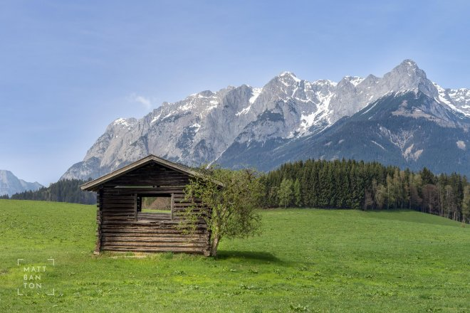 Landscape photo of alpine hut in the mountains
