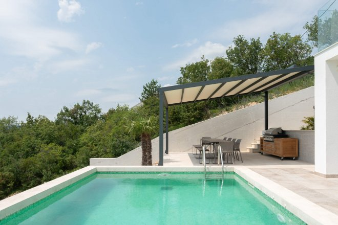architectural photo of pool and bbq